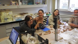 students in classroom, archaeological objects