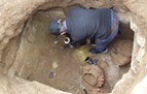 person in hole, archaeological dig