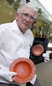 The late Dr Owen Powell with a late Roman plate featured on the front of his translation of Galen's 'On the Properties of Foodstuffs'