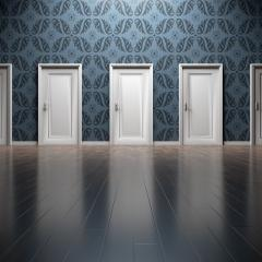 row of doors; Image via Pixabay, CC0 Public Domain