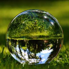 glass ball on grass; Image via Pixabay, CC0 Public Domain