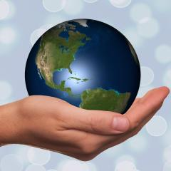 hand holding globe; Image via Pixabay, CC0 Public Domain