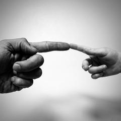 large hand, small hand, fingers touching, black and white; Image via Pixabay, CC0 Public Domain