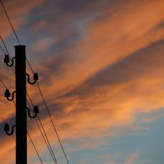phone lines, cloudy sky background; Image via Pixabay, CC0 Public Domain