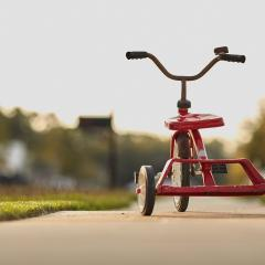 red tricycle; Image via Pixabay, CC0 Public Domain