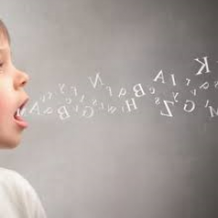 picture of child with mouth open and letters projecting forward